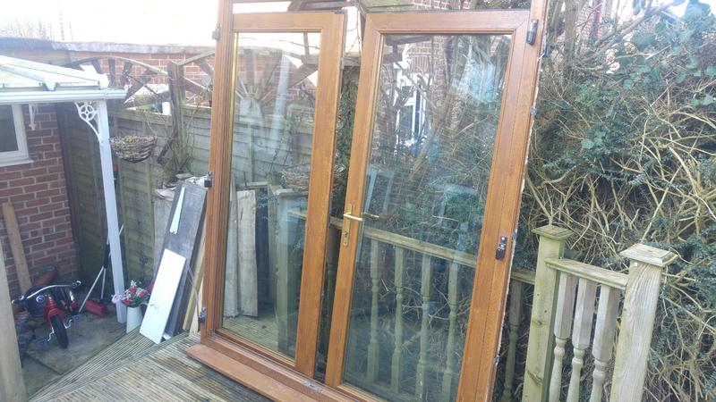 Upvc french doors newport wightbay for Wood effect upvc french doors